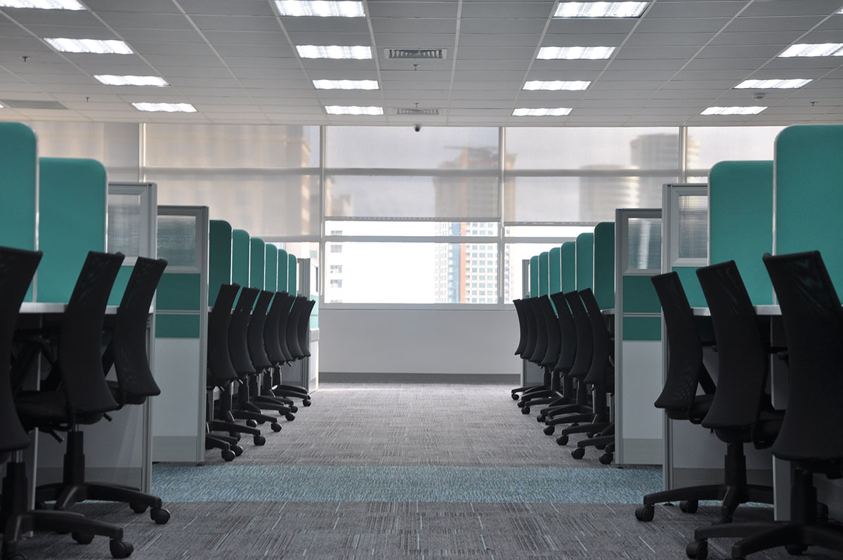 row of turquoise cubicles kate sade on unsplash